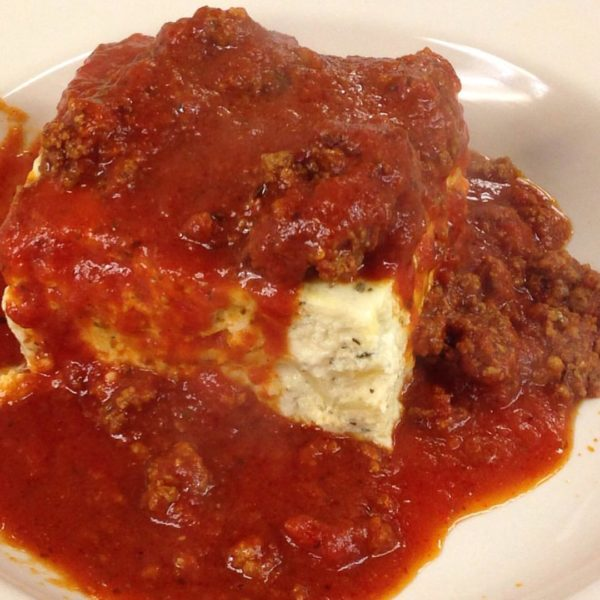 Baked Lasagna topped with meat sauce